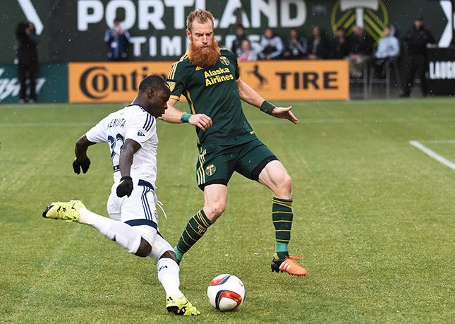 Vancouver Whitecaps forward Kekuta Manneh (23) tries to get past Portland Timbers defender Nat Borchers (7) during the second half of an MLS western conference semifinal soccer match in Portland, Ore., on Sunday, Nov. 1, 2015. The match ended in a 0-0 dra