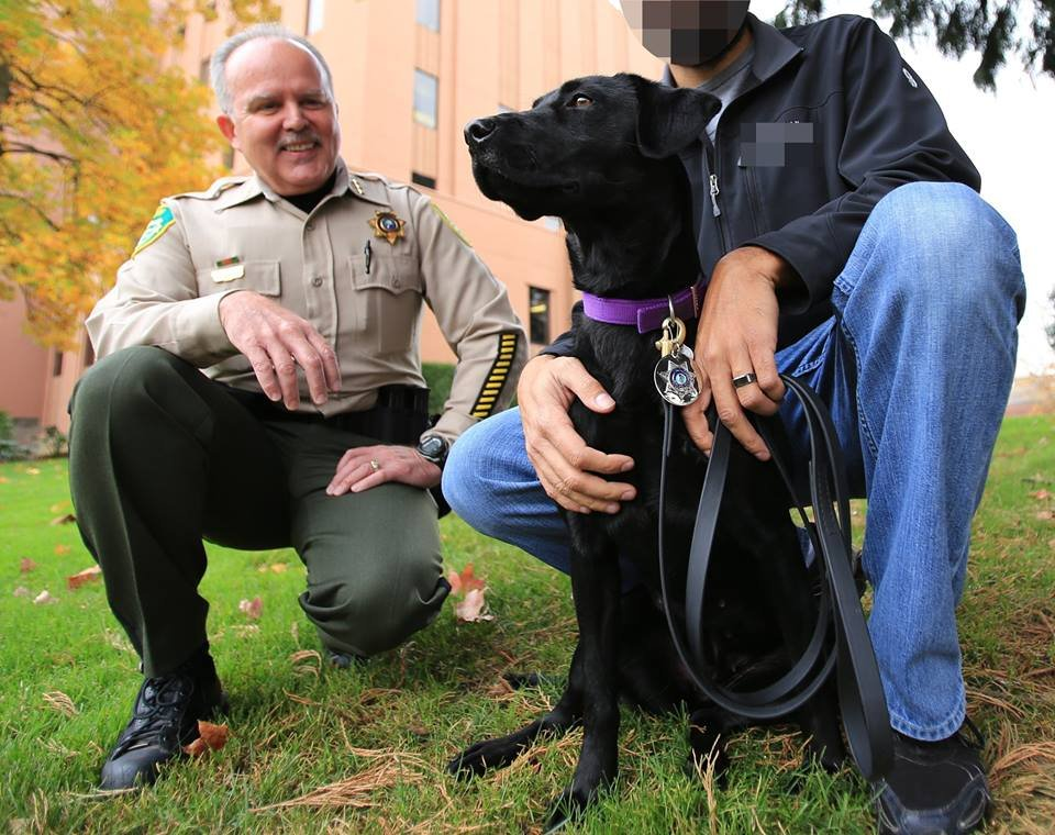 Piper and her handler, pictured right.  Courtesy of the Clark County Sheriff's Office.