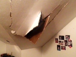 The damage to the bedroom shared by her two daughters.