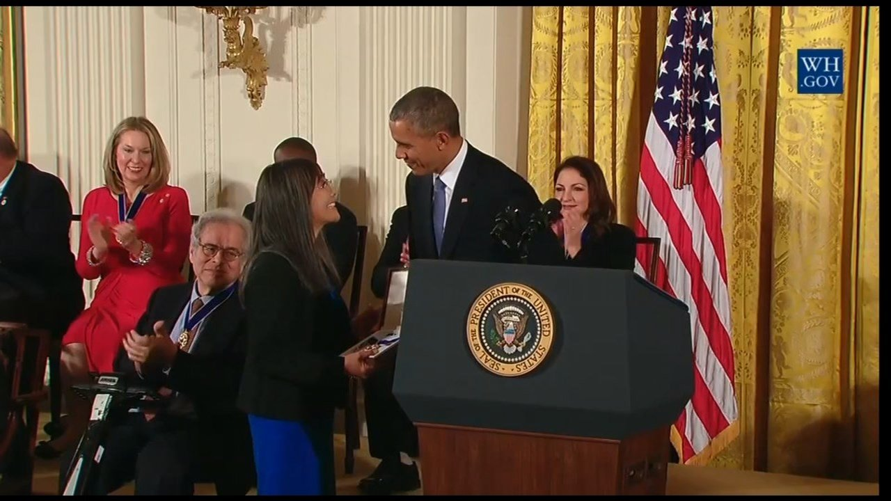 A family member receiving Yasui's Medal of Freedom from President Obama.