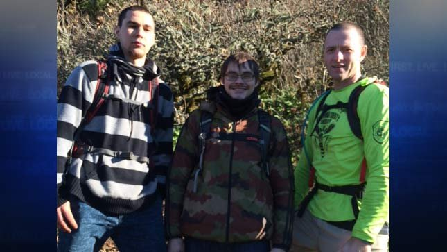Lost hikers with Green Hornet trail rescue team member. Photo: Multnomah County Sheriff's Office