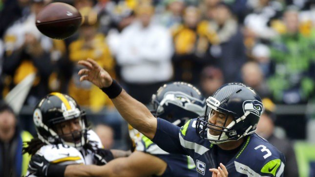 Seattle Seahawks quarterback Russell Wilson throws against the Pittsburgh Steelers in the first half of an NFL football game, Sunday, Nov. 29, 2015, in Seattle. (AP Photo/Ted S. Warren)
