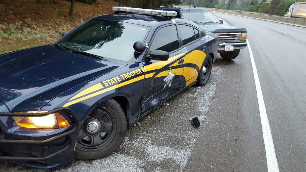 Oregon State Police said a trooper's patrol car was hit while responding to a crash on I-5 Monday morning (Photo: Oregon State Police/Twitter)