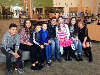 The Kozhokar family with Sparrow Clubs advisor and Parkrose Middle School teacher Laura Queen.