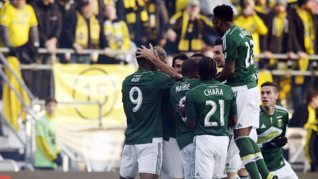 Portland Timbers celebrate their goal against the Columbus Crew during the first half of the MLS Cup championship soccer game, Sunday, Dec. 6, 2015, in Columbus, Ohio. (AP Photo/Paul Vernon)