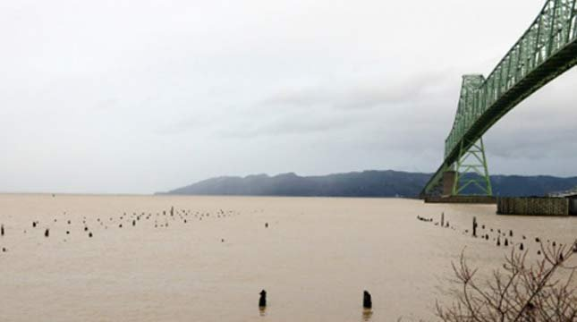 The Columbia River runs brown from silt and runoff after days of heavy rainfall in Astoria. U.S. Coast Guard photo by Petty Officer 3rd Class Jonathan Klingenberg.