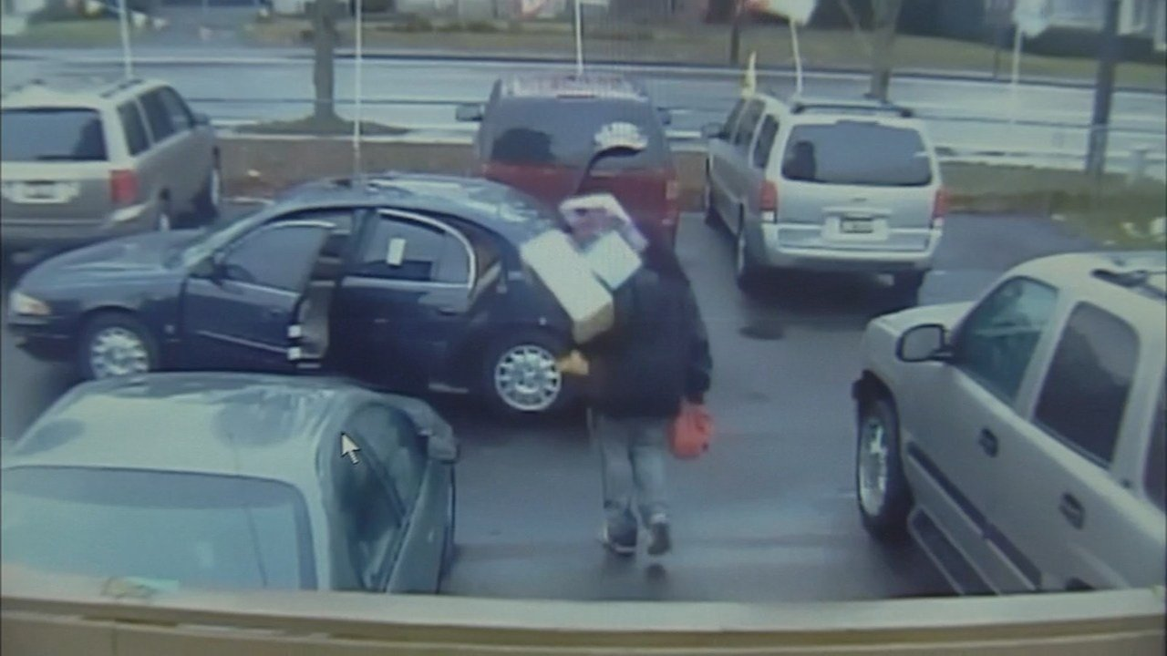Suspect carrying boxes that contained Christmas presents.