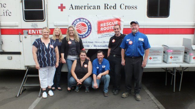 Employees with Jack Howk/Rescue Rooter pose in front of the American Red Cross bus during the last blood drive. (Photo: Jack Howk/Rescue Rooter)