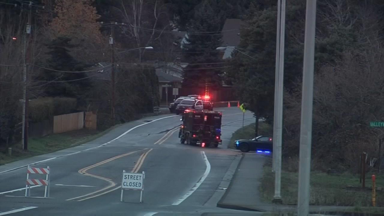 Police at scene of burglary, shooting in Salem on Dec. 10.