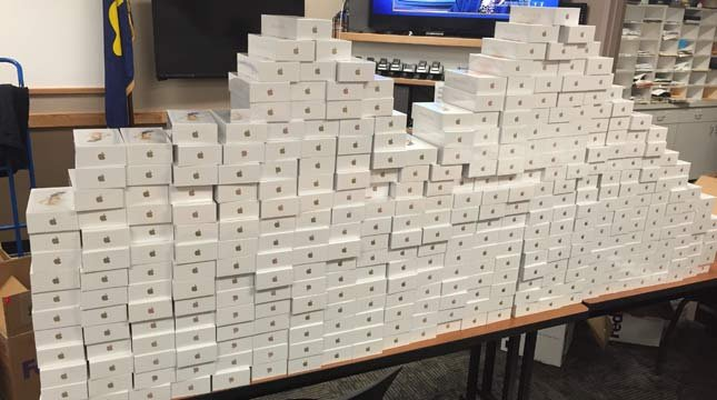 Evidence photo of seized iPhones in fraud investigation from Tigard PD