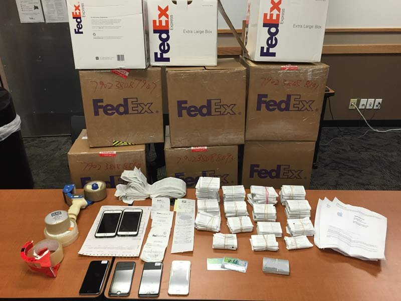 Evidence photo of seized gift cards in fraud investigation from Tigard PD