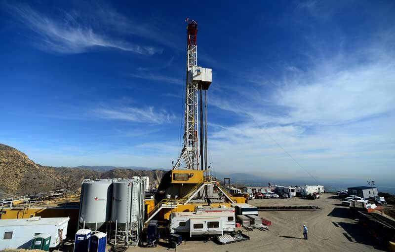 Crews from SoCalGas and outside experts work on a relief well at the Aliso Canyon facility above the Porter Ranch area of Los Angeles, Wednesday, Dec. 9. 2015. (Dean Musgrove/Los Angeles Daily News via AP, Pool)