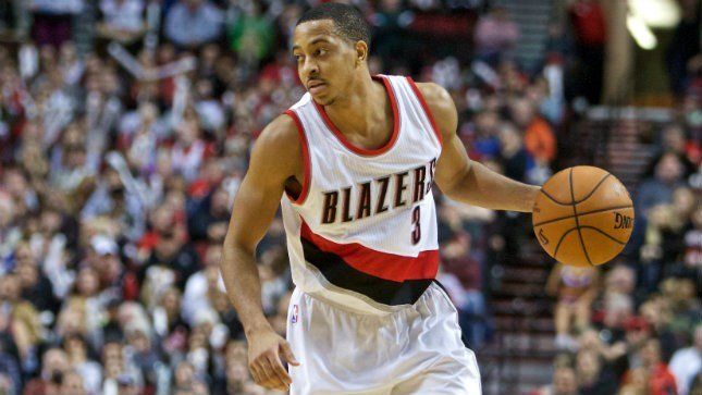 Portland Trail Blazers guard C.J. McCollum dribbles the ball during the second half of an NBA basketball game in Portland, Ore., Wednesday, Dec. 30, 2015. The Trail Blazers won the game 110-103. (AP Photo/Craig Mitchelldyer)