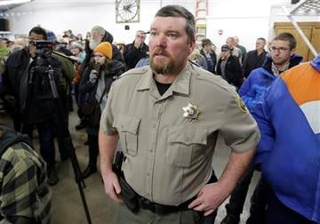 (AP Photo/Rick Bowmer). Harney County Sheriff David Ward arrives to a community meeting at the Harney County fairgrounds Wednesday, Jan. 6, 2016.