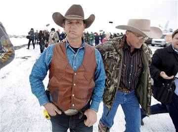 (AP Photo/Rick Bowmer). Ryan Bundy, one of the sons of Nevada rancher Cliven Bundy, walks to a news conference at Malheur National Wildlife Refuge Thursday, Jan. 7.