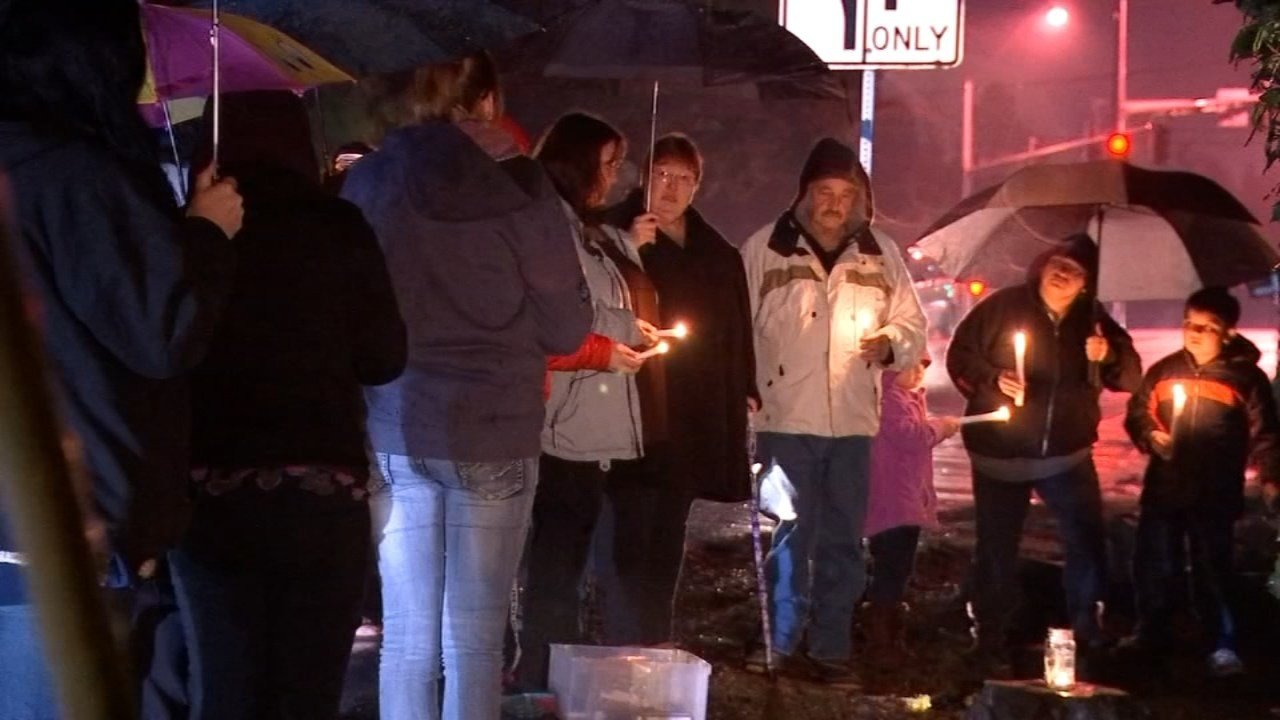 Crowd gathered to hold a vigil for Harley near SW Laurelwood Ave and Homewood Street.