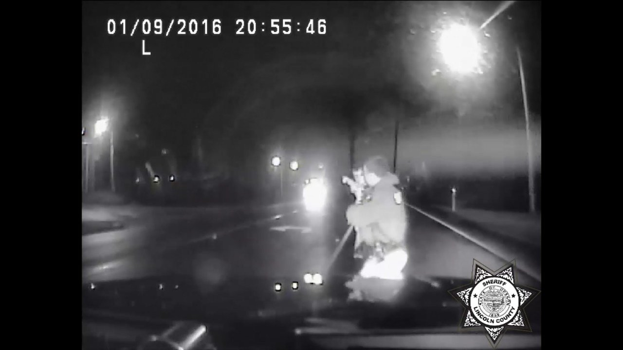 Image from dashcam video released by Lincoln County Sheriff's Office of a deputy stopping to help a boy running in the middle of Highway 101.
