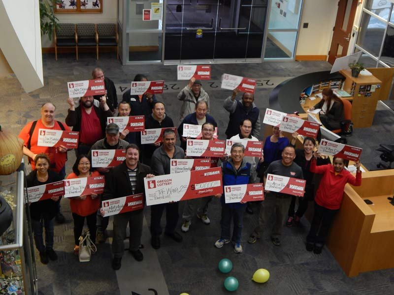 Many of the employees at Warn Industries who went in on an office pool for the record-setting $1.6 billion Powerball jackpot claimed their $50,000 prize last week. (Photo: Oregon Lottery)