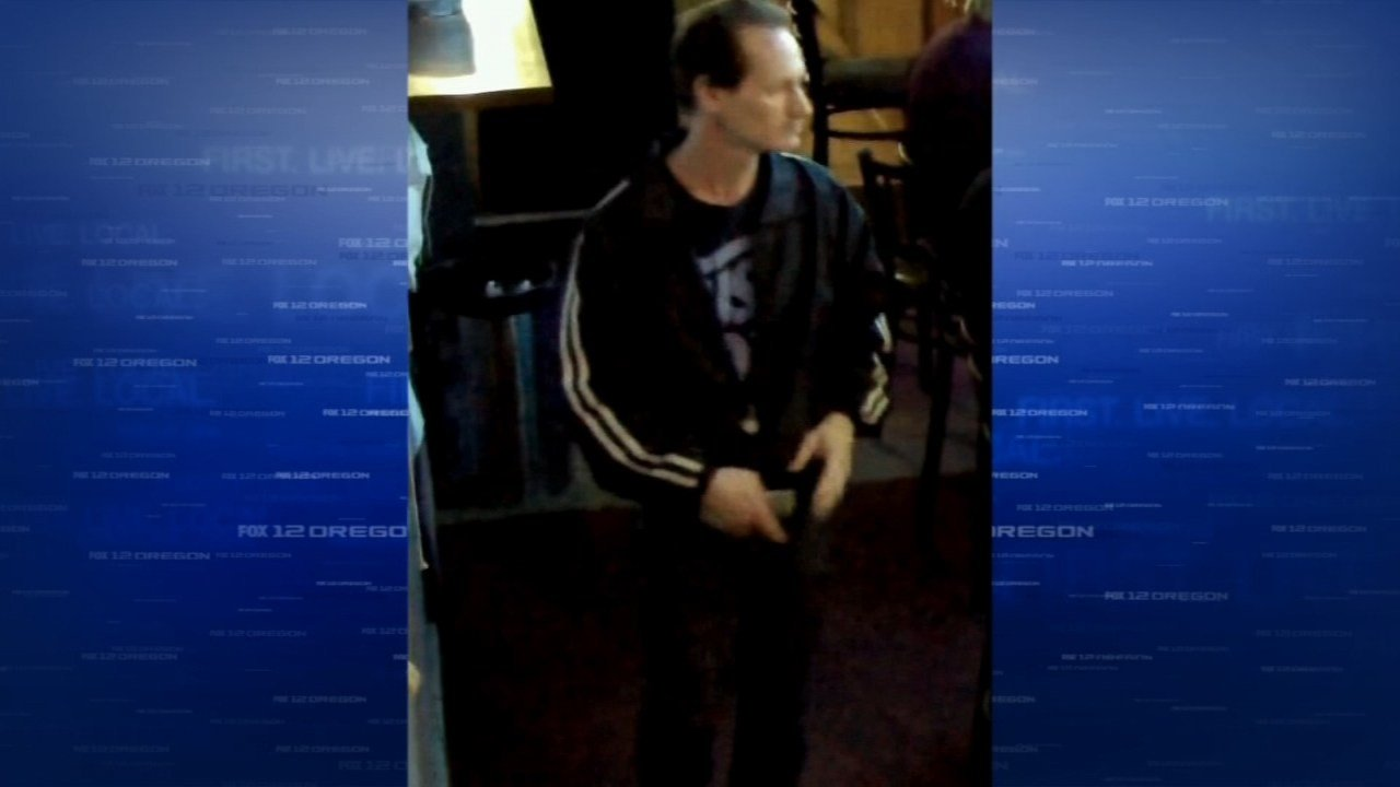 Surveillance image of dog theft suspect at Boss Hawg's Bar and Grill