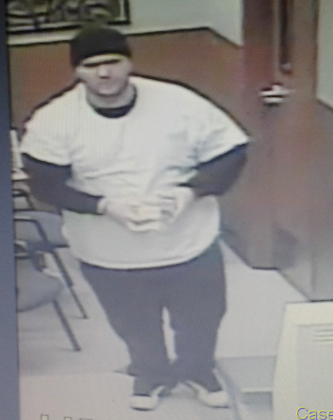 Surveillance image of suspect who stole diabetic testing equipment from QFC. (Image from Portland Police Bureau)