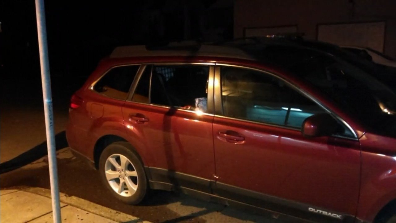 Jennie's car with a broken back window after the thief broke in. (Photo: Jennie Hogan Horton)
