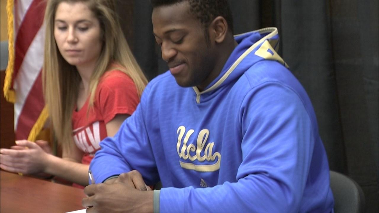 Osa Odighizuwa signing to UCLA.