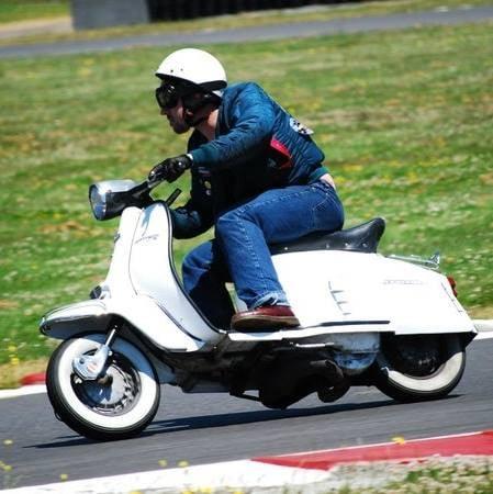 Wilson riding his Lambretta at PIR a few years ago.