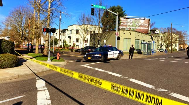Streets taped off in NE Portland for car-to-car shooting investigation.