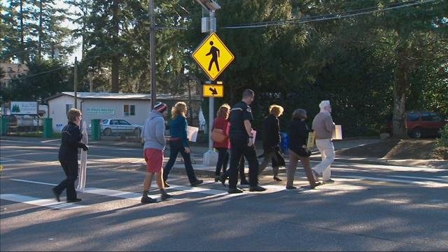 Flashing beacons for pedestrians installed at SE Portland intersections