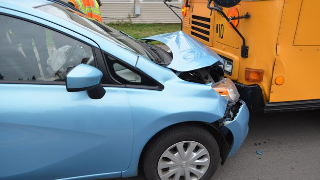 According to police, the driver of this blue Nissan Versa veered into oncoming traffic hitting this school bus which was carrying 53 students.