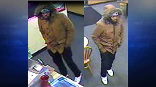 Surveillance images of wanted armed robbery suspect (Images released by Tigard PD)