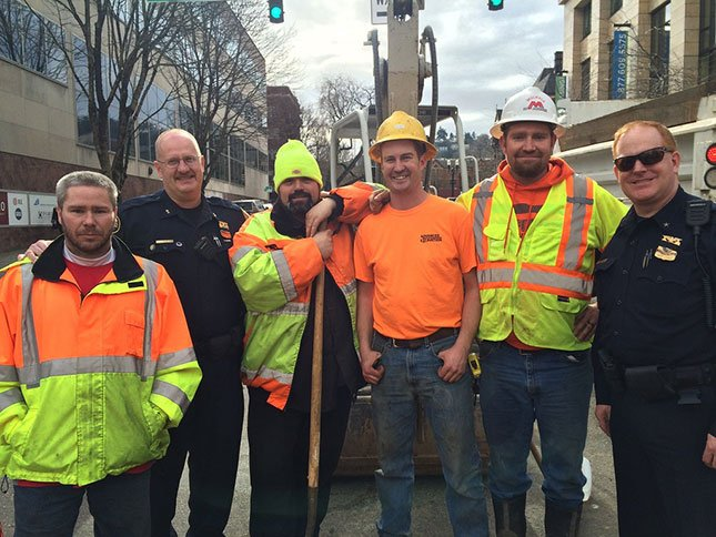 Chief Larry O'Dea, Assistant Chief Bob Day with the construction workers. (Photo: Portland Police Bureau)