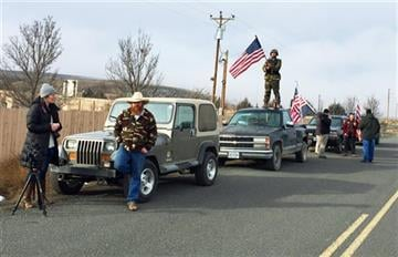 (AP Photo/Rebecca Boone). People protesting the FBI action and in support of the armed occupiers of the Malheur National Wildlife Refuge stand outside a roadblock near Burns, Ore., Thursday, Feb. 11, 2016.