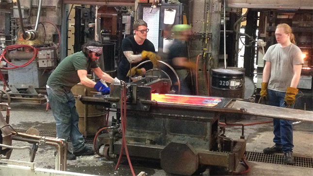 Staff working inside of Bullseye Glass Co. in Portland. Talking to Fox 12 Monday, the owner said he had no idea arsenic and cadmium emissions were a problem. (Simon Gutierrez, Fox 12)