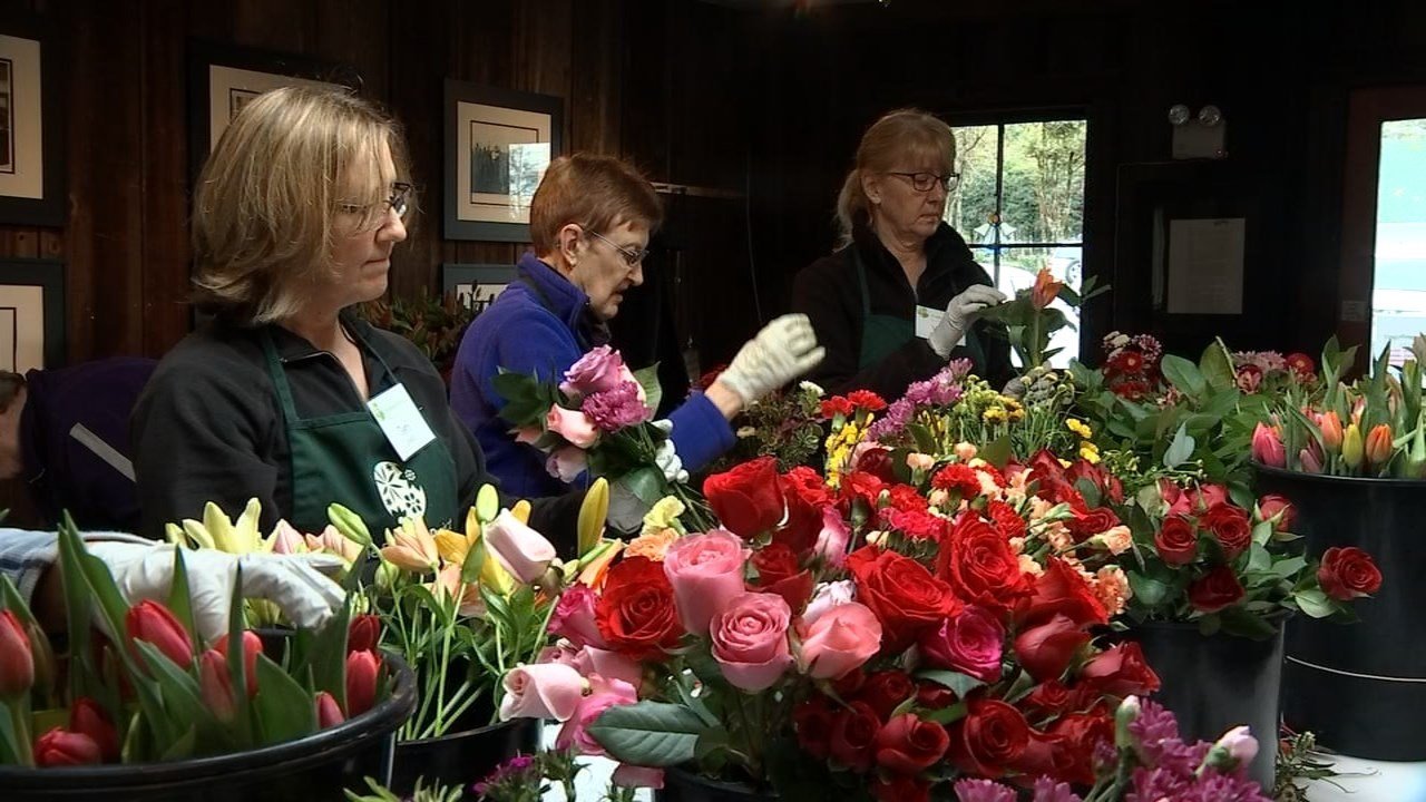 Volunteers created new bouquets with unused flowers.