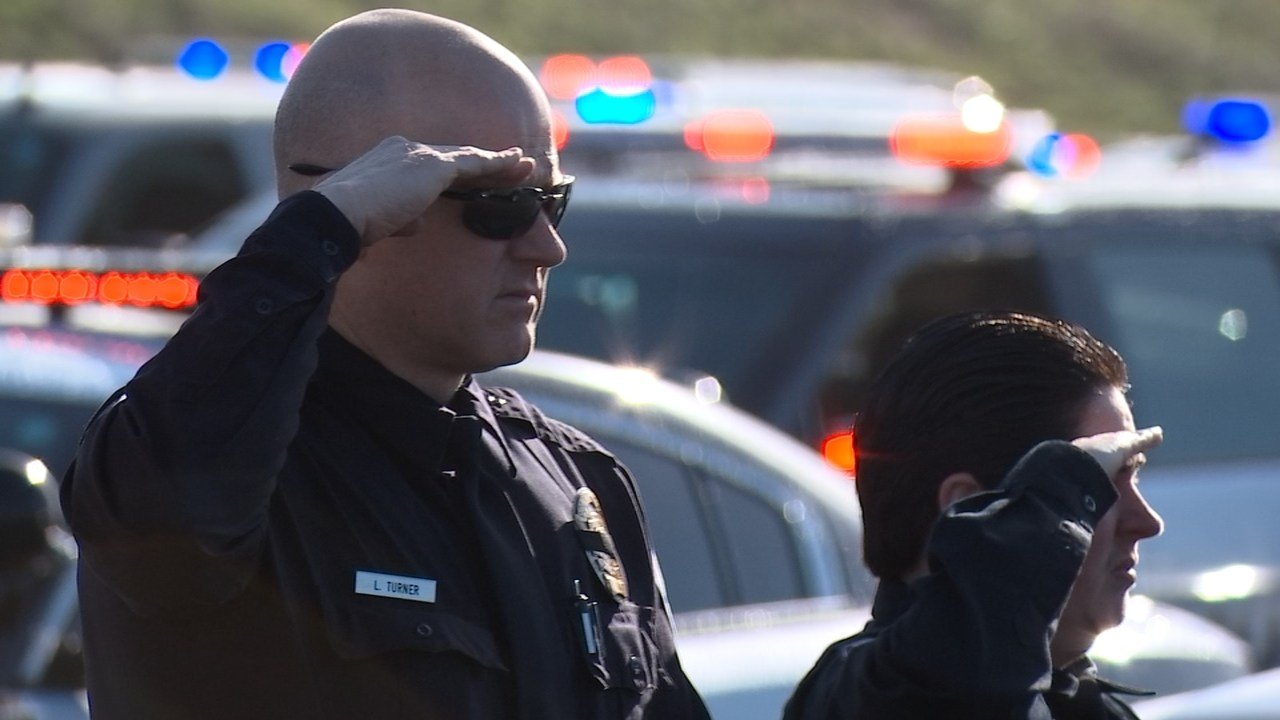 Officers honoring fallen Seaside officer Jason Goodding during a procession last week on the Oregon coast.
