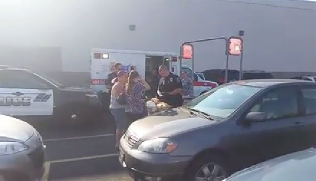 FOX 12 viewer photo of emergency response to baby left in hot car in Longview Fred Meyer parking lot in August 2015.