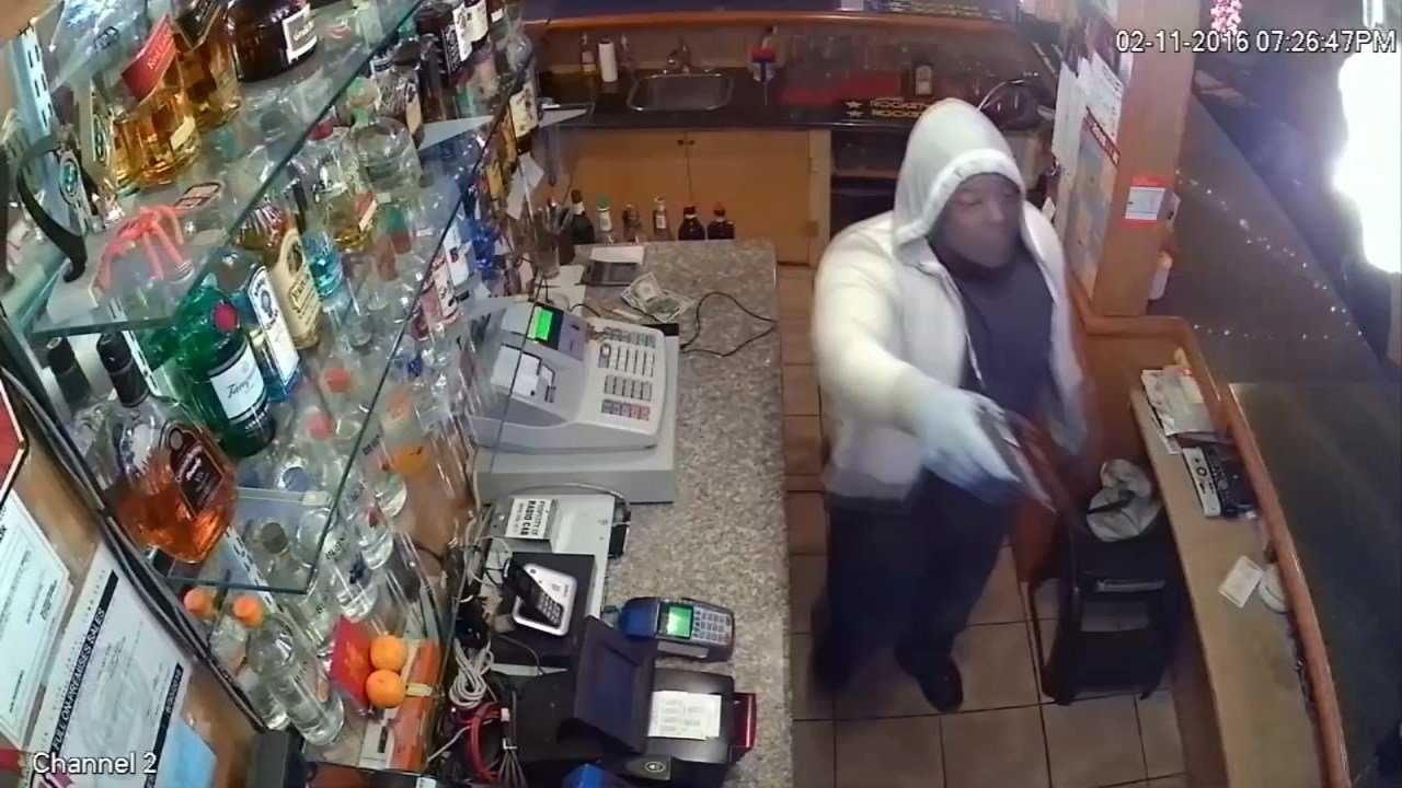 Surveillance image of armed robber at Andy's Bar in SE Portland.