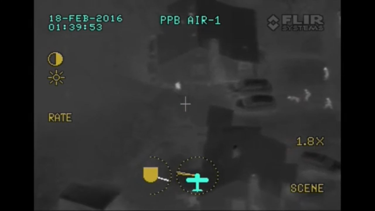 Officers converging on armed robbery suspect, center, in NE Portland. (Image from police plane FLIR camera, courtesy Portland Police Bureau)