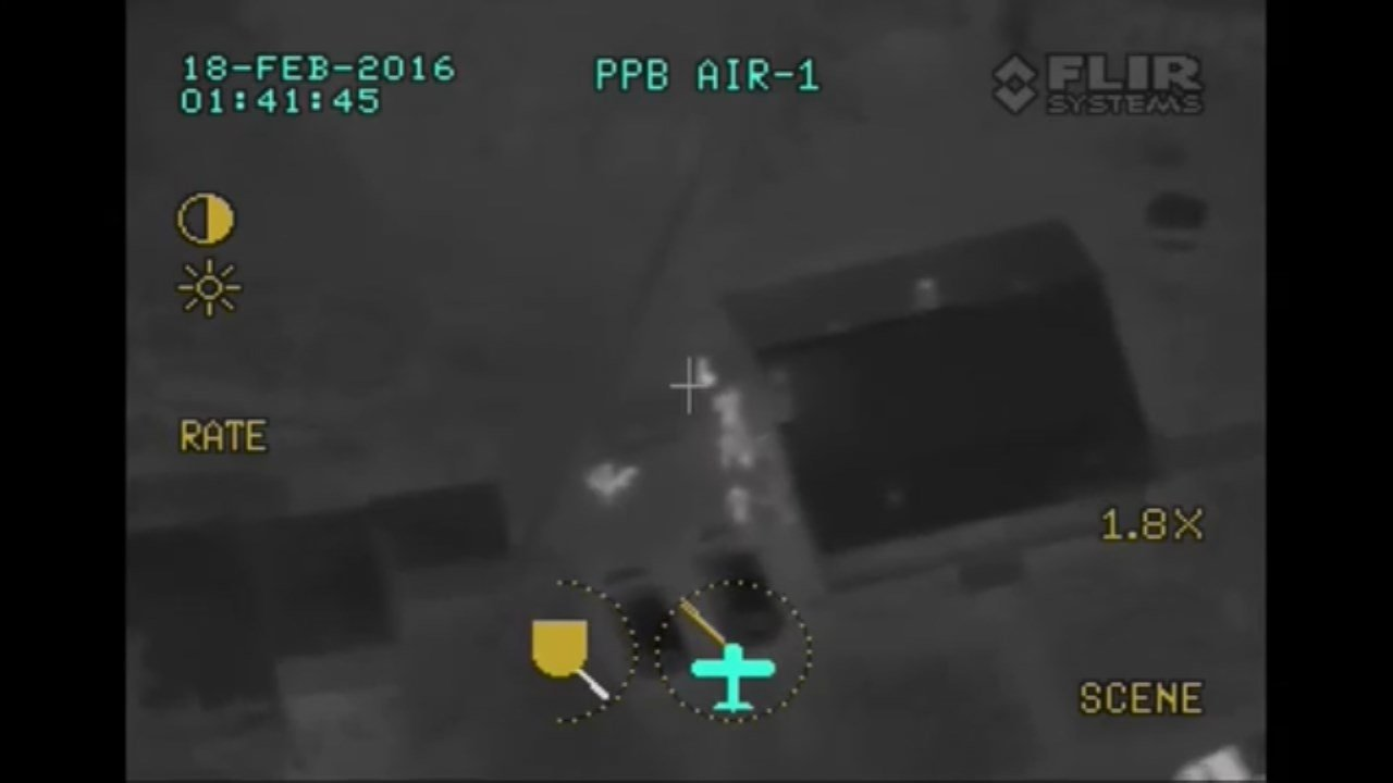 Police arrested an armed robbery suspect who was spotted by police from above. (Image from police plane FLIR camera, courtesy Portland Police Bureau)