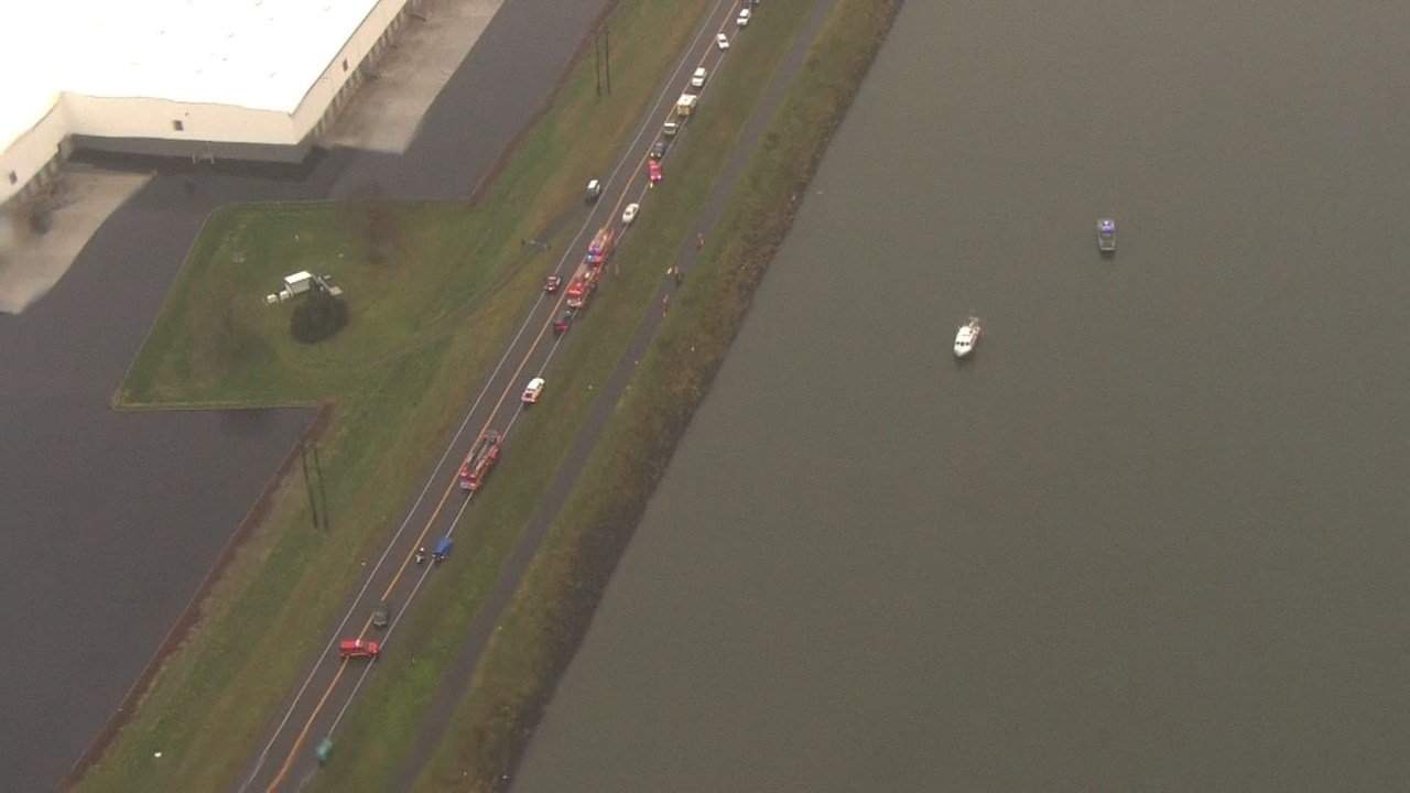 Rescue crews at scene of car into Columbia River off Marine Drive in Portland (Photo from Air 12)