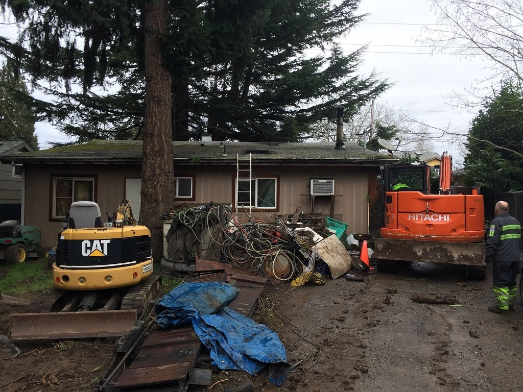 North Portland home where a theft suspect was arrested and stolen flatbed trucks and construction equipment were recovered. (Photo: Portland Police Bureau)