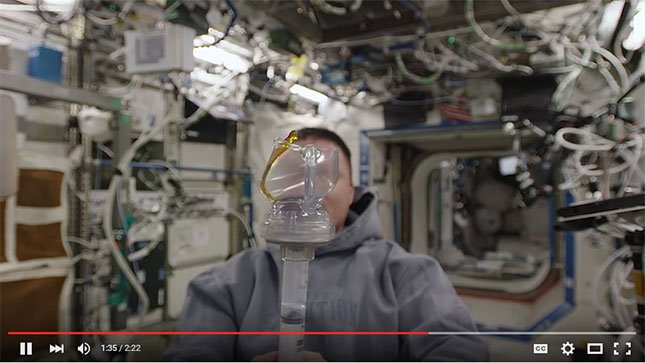 In a Youtube video, astronaut Kjell Lindgren describes how a new design by PSU students allows fresh brewed coffee to be made in space. (NASA YouTube Channel)