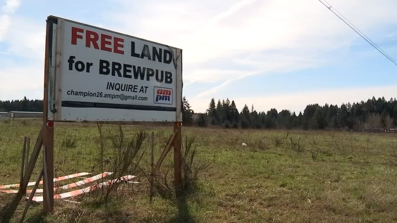 Sign along Highway 26 advertising 'free land for brewpub.'