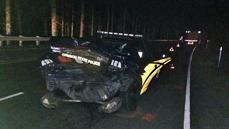An Oregon State Patrol Trooper was struck by an impaired driver while the trooper was stopped to help a disabled vehicle on Hwy 101 early Wednesday morning. (Oregon State Police)