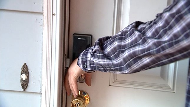 James Newman unlocking a door using a RFID chip implanted in his hand.