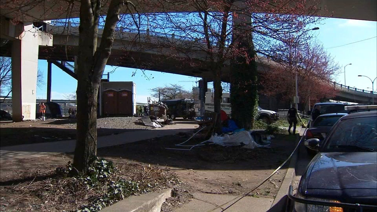 City crews and police officers worked to clear a homeless camp under Portland's steel Bridge Thursday. (KPTV)