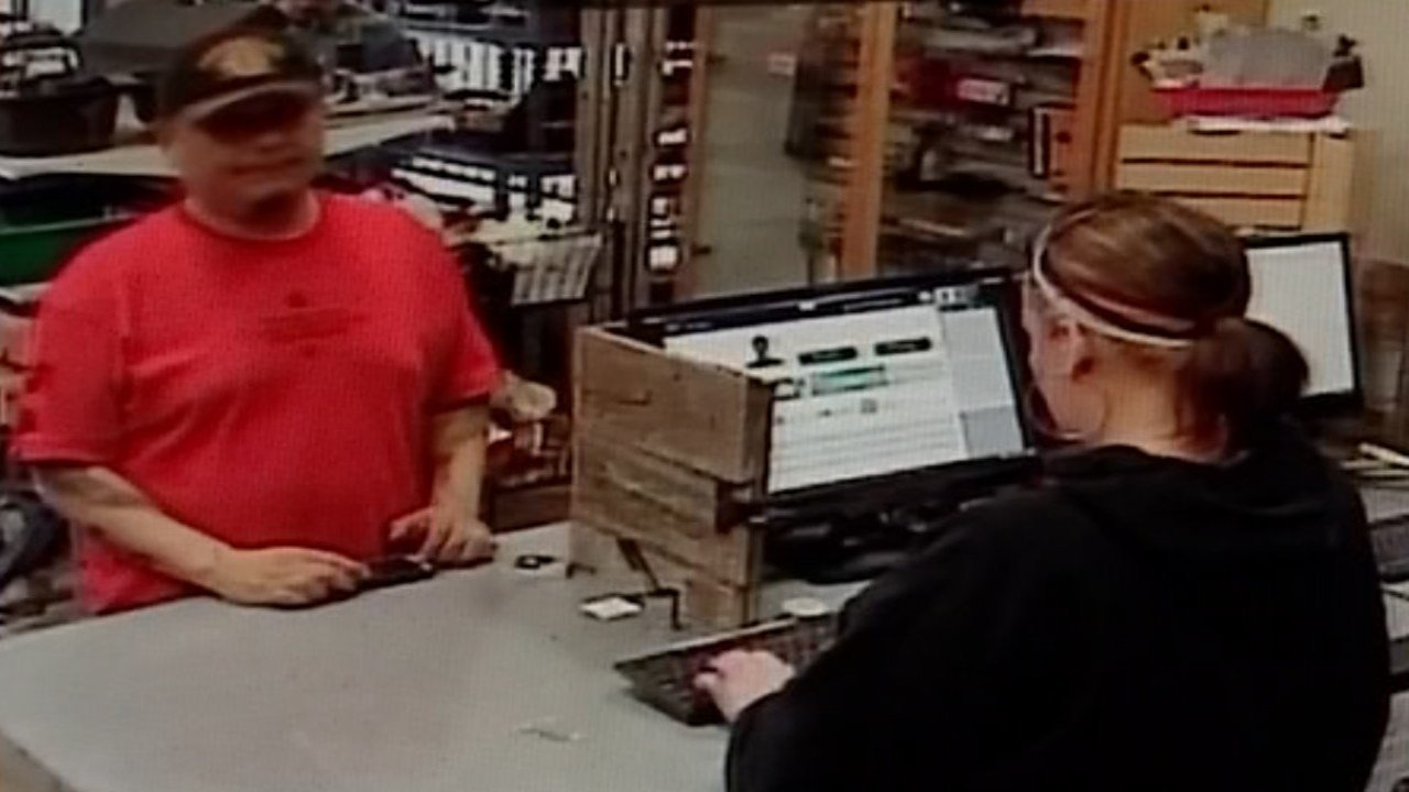 The surveillance video from Capital Pawn in Salem shows scam suspect Cruz Gonzalez in front of staffer Maria Lucero as she tried to get her co-worker's attention. (KPTV)