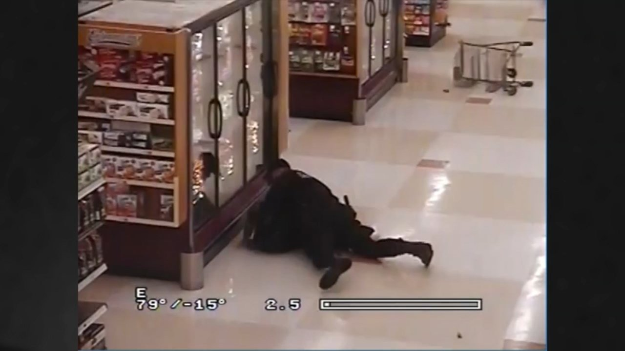 Surveillance image of police catching a suspect attempting to run away through a Fred Meyer store (Image: Portland Police Bureau)