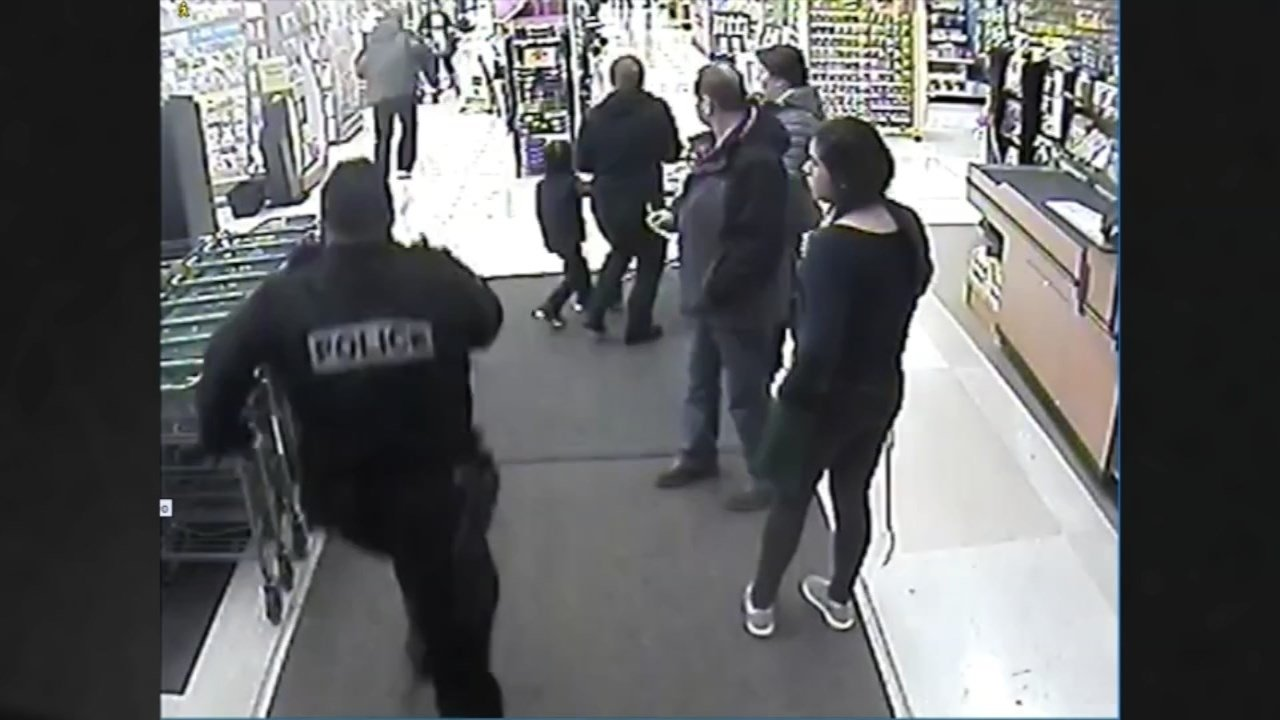 Surveillance image of suspect attempting to run from police through Fred Meyer store. (Image: Portland Police Bureau)